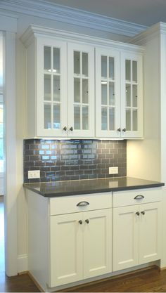 white cabinets with grey quartz countertops