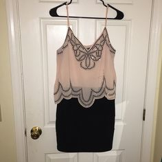 Going out Dress Black / Pink Only worn once. Very comfy. Tight on the bottom , loose up top. Dresses Mini
