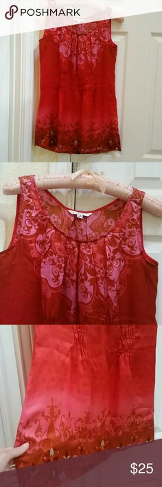 """*CAbi* 100% Silk Tank Hues of red and pink with Asian art design. Round neckline. Light elastic at middle front and back to add curves at waistline. Broad hem at bottom with slit on each side. Length 27"""". Beautiful and classy. Used once. Prestine condition! CAbi Tops Tank Tops"""