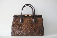 Brown handbag made with premium leather and cowhide. CA$250