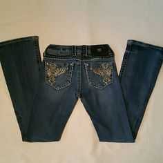 MISS ME BOOT CUT JEANS MISS ME BOOT CUT JEANS!! These jeans have vintage floating wings with bling. Pre-owned. Missing one big stone on rt back pocket. Good condition!!  BUY NOW!!  THANKS FOR SHOPPING!!  Miss Me Jeans Boot Cut