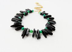Handmade Necklace - made from faceted genuine green fire agate gemstones and polished black agate nugget gemstones. The chain and clasp are 9ct