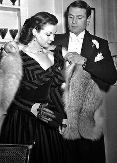 Vivien Leigh and Laurence Olivier getting ready to attend the premiere of Anna Karenina, January 1948.