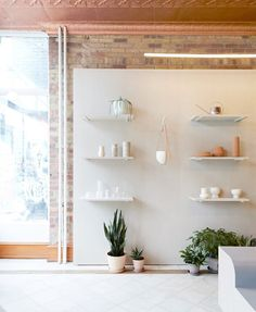 Toronto flower shop by MSDS Studio features pale walls and linoleum-covered furniture Vintage Wedding Centerpieces, Interior Architecture, Interior Design, Brickwork, Particle Board, Shop Interiors, Retail Design, Studio, Minimalist Design