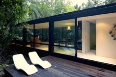 Decking with Simple White Loungers of Forest House