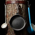Hanging Gear: (slide #54) Use an old leather belt and S-hooks to hang gear high around a tree trunk.