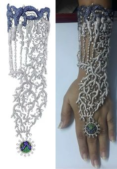 My #fuckminimalism post for today is this wonderful ode to over-the-topness... A traditional haath-phool hand ornament in white gold with tanzanites, diamonds, and emeraldsby Vaishal Jariwala. #queenbitchgoddesssize