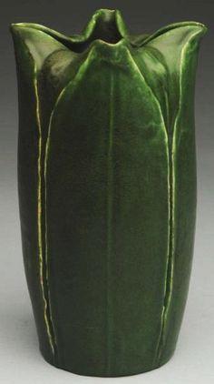 "Grueby Faience Company - Pinched-Rim Leaves Vase. Matte Glazed Pottery. Boston, Massachusetts. Circa 1898-1908. 8"" x 4""."