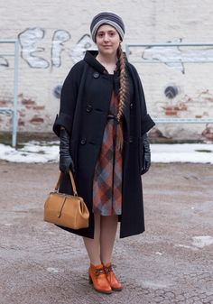 """Julie, 26  """"I love the style of the 60s and the 70s. Mad Men inspires me especially. Before my style was more feminine and I was more into the 50s.  Now I'm wearing a turban and a dress from Uff, a 40s coat from Etsy.com, shoes from Zio and a bag fromMekkomania."""""""
