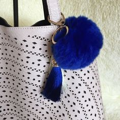 Cobalt Blue Pom Pom with Tassels Keychain New in package! Rabbit fur with gold tone keychain. I have lots of reviews on these, check them out!  Price is firm unless bundled. 10%OFF 2+                                                                         Colors I have: Tiffany blue, hot pink, light pink, white, gray, purple, black and cobalt blue.                   **without tassels $10** Accessories Key & Card Holders