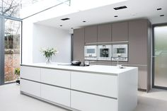 Amersham 1 - Polar white satin lacquer cabinetry - Cashmere satin lacquer tall cabinetry - Desinger white corian - Gagganau Appliances - Blanco Sink & Tap