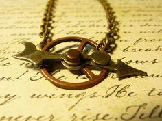 Steampunk arrows and clockwork gear pendant necklace by vintagerust. $16.00, via Etsy.