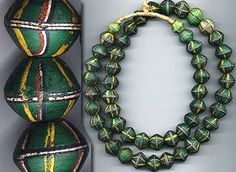 Another from our exceptional collection of King Beads. The beads on this green King Bead strand are not in as exceptional condition as several of the others -- while none of the beads are broken, seve