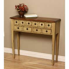 Bring a new touch of style to your home decor with this elegant Humphry Huntboard console table. A brilliant honey finish combines with ten drawers and brass hardware to complete this incredible table.