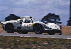 A rare color photo of the Chaparral 2D take during the 1967 Sebring 12 hours. After Daytona, the bodywork was revised adding a larger rear spoiler and mustache spoilers on the nose. The car had the speed to outrun the GT-40 MK.IIb, but the gearbox failed. The lack of a pair of top tier drivers in the 2D meant that it would never attain its maximum speed potential at Sebring, nor had it done so in the previous race at Daytona. Duke Q. Manor photo.