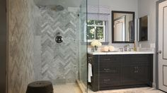 dark cabinet, herringbone tile