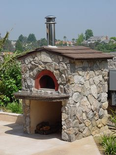 Outdoor pizza oven by oliveto, via Flickr