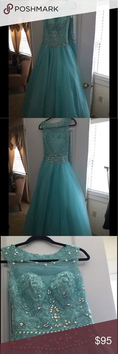Turquoise blue formal dress. Turquoise blue formal dress. Net swarvorski embellished skirt and beaded top. Perfect for prom or homecoming dances, Quinceañera, or weddings. Dresses Prom