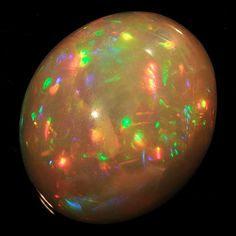 Opal oval cabochone, 12.23 cts from  Ethiopia. More @ www.multicolour.com and #gemstones