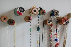 Love this idea for hanging necklaces- DIY thread spool holder