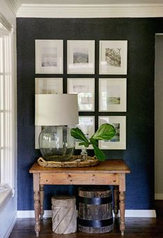 """Southern Newlywed: At Home with Cary and Ryan Ray - Southern Weddings Dark (blue) accent wall to display/showcase photos/art. perfect for entryway or an otherwise """"empty"""" area Home Interior, Interior Design, Interior Office, Modern Interior, Dark Accent Walls, Navy Walls, Black Walls, Sweet Home, Wall Decor"""