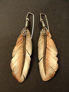 Feather Earrings created using polymer clay, mica powder and a safety pin!