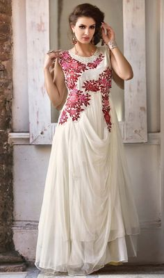 Dazzle like a newly discovered star donned in to this off white embroidered georgette and net gown. Look ravishing clad with this attire that's enhanced butta, lace, moti, resham and stones work. #FabulousDesignPartyGown