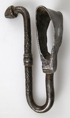 Belt Hook Date: 15th century Culture: French Medium: Wrought Iron Dimensions: Overall: 3 1/8 x 1 7/16 x 1 7/8 in. (8 x 3.7 x 4.7 cm)