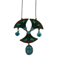 Eygptian Revival Pendant from the 1930's France. Lovely matte enamels in lotus motifs with faience scarab and pendant drops.