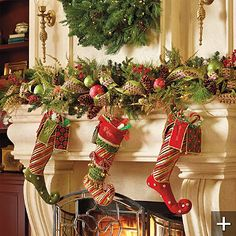 Christmas Garland and stockings bank greenery on mantle, none hanging down