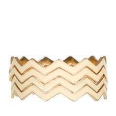 Unique set of zigzag stacking bangles, gold-tone alloy base with ivory enamel exterior finish. Four bangles included in each set.