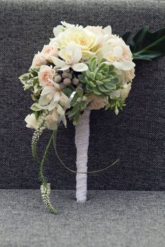 Rustic wedding bouquet with roses, echeveria succulents, grey brunia