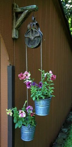 small pulley with buckets and flowers -Put it on the side of the garage next year #flores