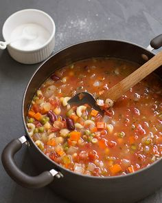 Simple, Satisfying Minestrone Soup With Olive Oil, Onions, Celery, Large Carrots, Garlic, Chicken Broth, Diced Tomatoes, Garbanzo Beans, Kidney Beans, Pasta, Frozen Peas, Fresh Oregano, Salt, Pepper
