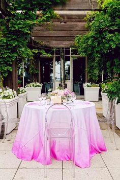 Cutest pink ombre tablecloth + ghost chairs