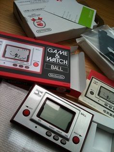 Nintendo Game Watch. Think I still have mine somewhere, Fire I think it was called it had people jumping out of a burning building you had to catch them on a fireman's stretcher!!?