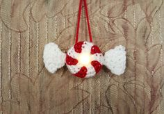 http://www.frommmetoyou.com/lighted-peppermint-candy-ornament-free-pattern/       Candy Ornament