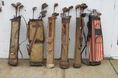 A collection of vintage, English golf clubs with bags. UK, circa 1940s.