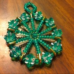 Ornament with safety pins and beads