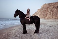 OMG!! All time fantasy.... riding a gorgeous black fresian on a beach... so wish i could do this.