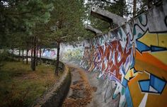 This photo shows an abandoned bobsled Olympic stadium.