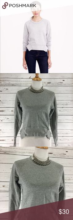 """{J. CREW} Grey Crop Peplum Sweatshirt Size XS Super soft and cozy crop peplum style sweatshirt from J. Crew.  First photo is stock photo in a lighter color to show shape .  Color is the grey material shown in the rest of the photos .  100% cotton .  EUC, no flaws .  All measurements taken flat .  Size XS measures shoulder to hem 20"""", armpit to armpit 17"""", waist 15"""".  J-6 J. Crew Tops Sweatshirts & Hoodies"""