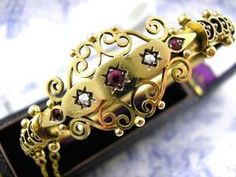 "Antique Etruscan Revival Bracelet in the style of Castellani made from 9ct Rose Gold set with Sparkling Rose Cut Diamonds, Deep Red Bohemian Garnets and a Central Ruby. Will fit up to a 7"" inch wrist size.  http://www.kittysantiquejewelry.com/Victorian-Gold-Bracelet-Etruscan-Bangle-p/ba11592.htm"