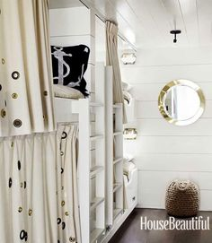 The bunk room in a Marin County, California home feels like a ship's cabin and is lined with six bunks, four on one side and two on the other.