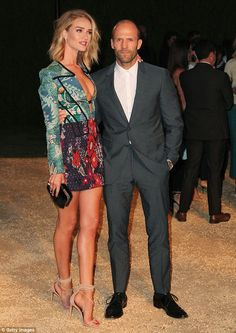 Handsome couple: Rosie Huntington-Whiteley displayed her phenomenal model body as she cosi...