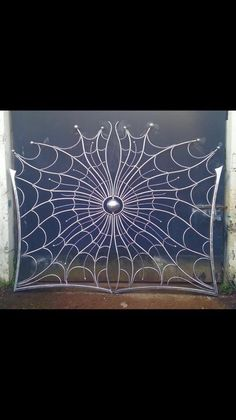 This spider webs swing gate would be perfect designed in black iron