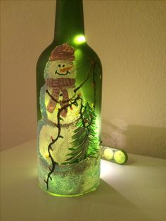 Snowman decorating tree