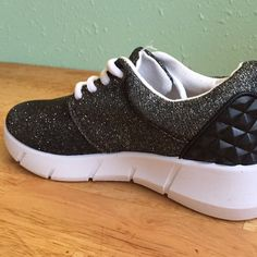 NWT dark sparkle sneakers with spike detail Brand new in box. Leather detail on heel is on trend for summer. Would look great with skinnies too. Sparkle is on top of a dark grey fabric. Shoes Sneakers