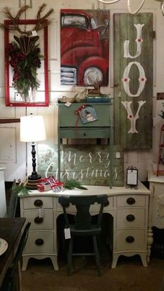 love this farmhouse christmas style.. country furniture the painted red truck and christmas signs..