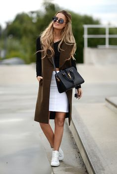fall / winter - street style - street chic style - casual outfits - fall outfits - comfy outfits - white denim skirt + black crop top + brown sleeveless coat + black shoulder bag + black round sunglasses + white sneakers